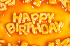Happy Birthday. Alphabet shaped pasta forming HAPPY BIRTHDAY in tomato sauce Stock Images