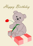 Happy Birthday. Bear with gift and tulip Stock Photo