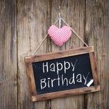 Happy Birthday. Blackboard: Happy Birthday on wooden ground Stock Photography