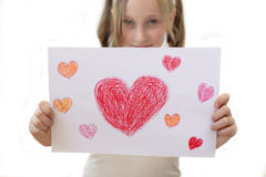 Happy Birthday. Girl is holding a picture with hearts Royalty Free Stock Image