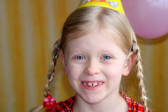 Happy birthday. Smiling, little girl in a party hat Royalty Free Stock Images