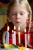 Happy birthday. Little girl blowing candles Stock Image