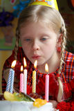 Happy birthday. Little girl blowing candles Stock Photography