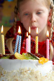 Happy birthday. Birthday cake against a background of a little girl Stock Photos