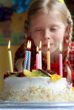 Happy birthday. Birthday cake against a background of a little girl Stock Images