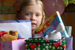 Happy birthday. Litlle girl with her gifts Stock Photography