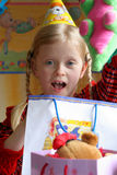Happy birthday. Little girl enjoying her birthday present Royalty Free Stock Image