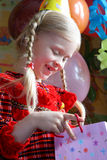 Happy birthday. Little girl looking a present bag Royalty Free Stock Images