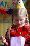Happy birthday. Little girl looking inside a present bag Stock Photography