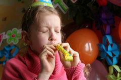Happy birthday. Young girl making noise Stock Photo