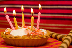Happy birthday. Birthday candles and cake on striped background Stock Images