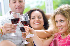 Happy birthday. Portrait of young happy attractive people having some wine Royalty Free Stock Images