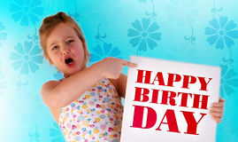The happy birthday. A girl is holding a happy birthday frame in her hands Stock Photos