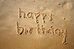 Happy birthday. Written in the sand Stock Images