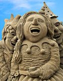 Happy birthday. Happy sand sculptures celebrating and laughing Stock Photography