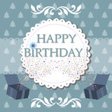 Happy Birthday. Abstract colorful background with two present boxes with confetti and the text Happy Birthday written in blue in the middle of the image Royalty Free Stock Photo