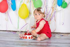 Happy birthday baby. Little girl with group balls and cake stock image
