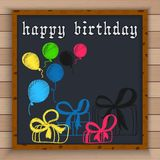 Happy birthday background with color balloons and gift boxes written by color chalk on blackboard Stock Image