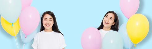 Happy birthday. Balloon party. Happy asian girl with balloons isolated on blue background. Copy space stock image