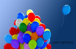 Happy birthday balloons. Bunch of colorful balloons on blue background Stock Images