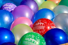 Happy birthday balloons. Floating in a pool Royalty Free Stock Image
