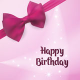 Happy Birthday. Birth Greeting card. Backlight on the background decorated with pink bow. Stock Photo