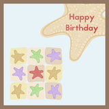 Happy Birthday. The birth Greeting card is decorated with a starfish on the beach. Greeting card Happy Birthday. The birth postcard is decorated with a starfish Royalty Free Stock Photo