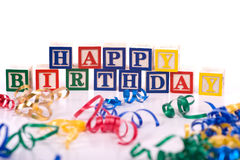 Happy Birthday Blocks. On a white background with copy space, including streamers stock photography