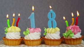 Happy 18 birthday, blue burning number candles on cakes
