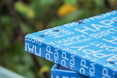 Happy Birthday box with silver stars on the lid. Present in blue box, boys birthday celebrations Stock Photography