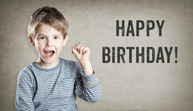 Happy birthday, Boy on grunge background writing Royalty Free Stock Photography