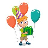 Boy holding birthday gifts. Happy birthday boy holding gift box with balloons and hat Stock Image