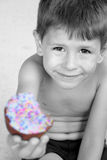 Happy birthday boy smiling with cupcake. Happy cute birthday boy smiling with a frosted cupcake Royalty Free Stock Photography