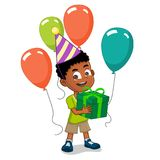 Boy holding gifts with balloons. Happy birthday boy wearing hat holding gift box with balloons Stock Photos