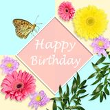 Happy birthday bright greeting card concept with flowers and but. Happy birthday bright greeting card concept with gerbera flowers, chrysanthemums and butterfly royalty free stock image