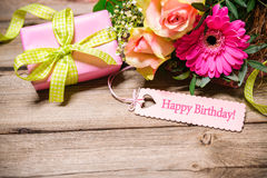 Happy Birthday. Bunch of flowers and tag with text on wooden background. Happy Birthday Stock Image