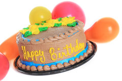 Happy birthday cake. Surrounded by balloons stock photography