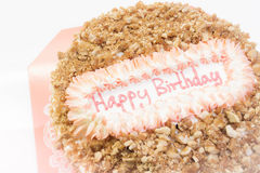 Happy birthday cake. Almond crispy caramel birthday cake in soft mode royalty free stock photo