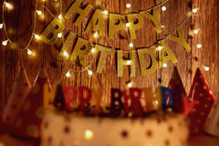 Happy birthday cake  on the background of garlands and letters Royalty Free Stock Image