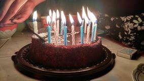 Happy birthday cake. With candles lights on the table royalty free stock images