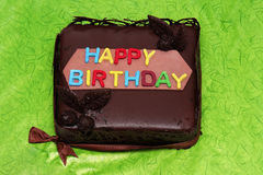 Happy birthday cake. Chocolate cake with happy birthday colorful letters stock image