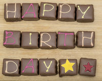 Happy birthday cake. Happy birthday chocolate cake on a wooden background royalty free stock photo