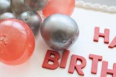 Happy Birthday Cake. Details of a happy birthday cake, on white background stock photos