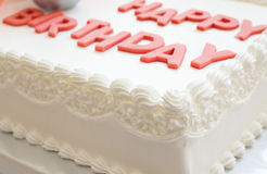 Happy Birthday Cake. Details of a happy birthday cake, on white background stock photography