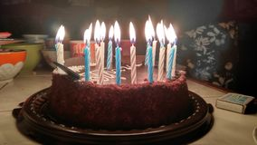 Happy birthday cake. With candles lights on the table royalty free stock photos