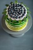 Happy birthday cake. Nice sponge happy birthday cake with mascarpone and grapes on the cake stand royalty free stock images