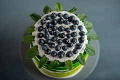 Happy birthday cake. Nice sponge happy birthday cake with mascarpone and grapes on the cake stand royalty free stock photography