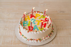 Happy birthday cake. On table stock photography