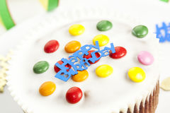 Happy Birthday Cake. Happy Birthday written on a small cake with smarties stock photos