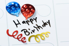 Happy birthday on a calendar Stock Images